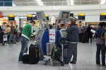 Automated check-in and the metal basket is for you to measure if your hand baggage is the correct size